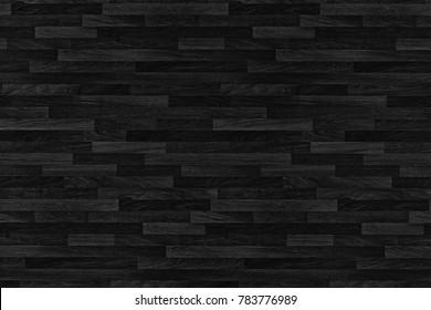 Black wood parquet texture. Background old panels.