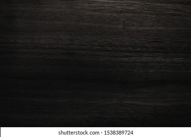 Black wood texture background coming from natural tree. Abstract dark wooden panel with beautiful patterns.Background for interior design.