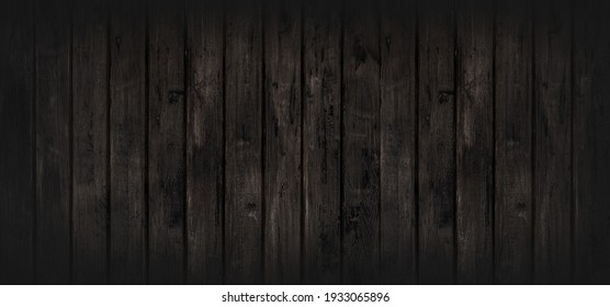 Black wood texture background coming from natural tree. The wooden panel has a beautiful dark pattern, hardwood floor texture