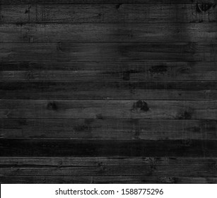 Black wood texture wall for background.