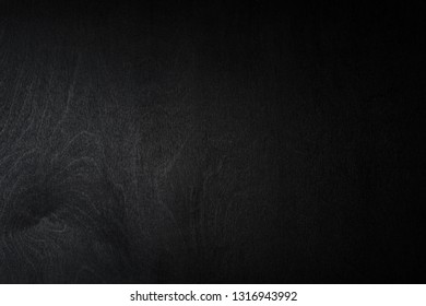 black wooden background with lighting on the left