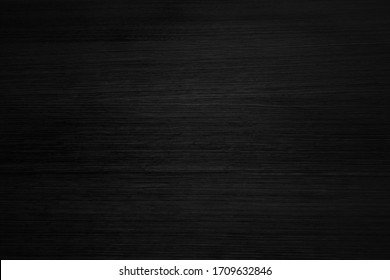 Black wooden background or texture