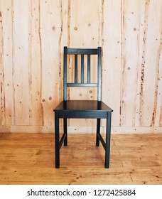 Black wooden chair  in the wooden house.