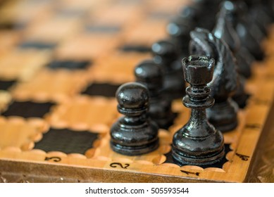 Black wooden chess background. Business concept.