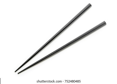Black Wooden Chopsticks isolated on white background. Asian Food Chopsticks