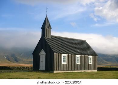 Black Wooden church in autumn in Budir, Iceland