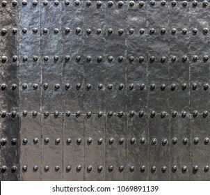 Black wooden gate or wall with steel rivets. It is Japanese architecture design.