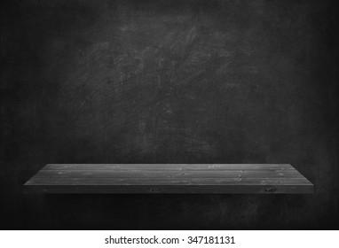 Black wooden plank on dark wall