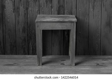 black wooden stool on a black wooden floor
