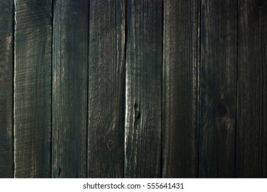 Black wooden surface. Part of old wooden wall. Texture, background.