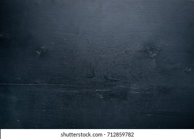 Black wooden surface. Top view. Free space for text.