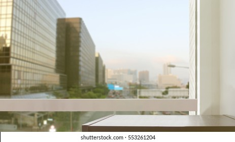 black wooden table at glass window of city view background