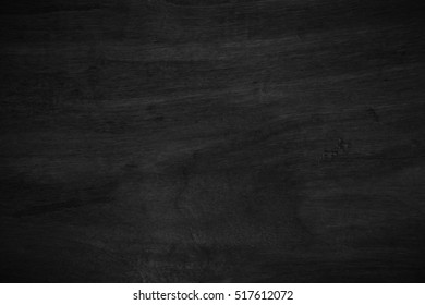 black wooden texture or wood grain pattern background