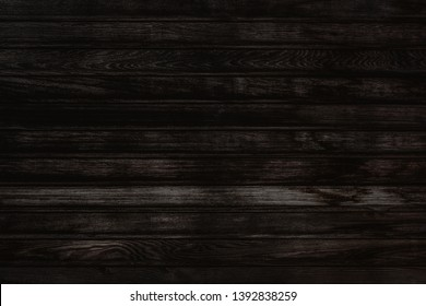 Black wooden wall texture of dark bark wood with old natural pattern