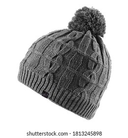 Black Wool Knit Ski Hat with Faux Fur Pompom Isolated on White. Knit Cap Folded Brim. Tuque or Toque Outdoors Headgear. Bobble Hat Topped with Pom Pom or Loose Tassels. Knitted Warm Hat