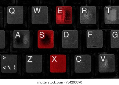 black worn computer keyboard the letters s e and