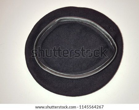 0fcabd589715a Black woven beret flat-crowned hat isolated over the white background