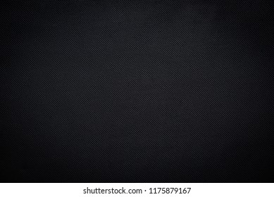 Black woven carbon fiber sheet texture background with lomo effect