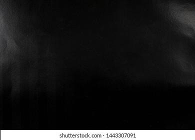 black wrinkled paper texture for you design background.