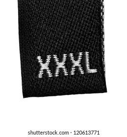Black XXXL size clothing label tag, fabric, isolated on white, detailed macro closeup