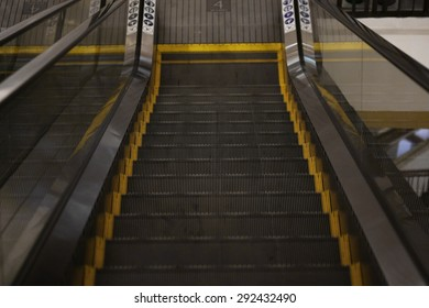 black yellow escalator background ,Abstract background texture of striped pattern of metal escalator foot step