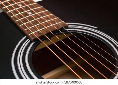 Black and yellow guitar strings closeup macro photography