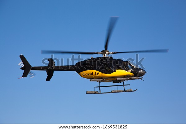 black-yellow-helicopter-inscription-covi