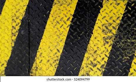 Black and yellow line paint on non-slip metal background