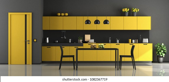 Black and yellow modern kitchen with dining table and chairs - 3d rendering