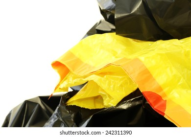 Black and yellow plastic bags on a white background