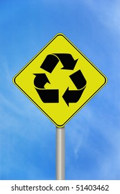 A black and yellow recycle sign with the recycling symbol
