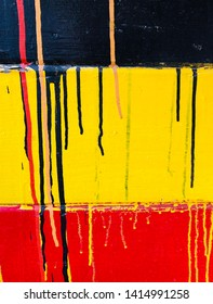 Black yellow and red paint drip background