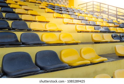 Black and yellow seats on the grandstand of the football stadium, Outdoors empty grandstands temporary builded for country town parade