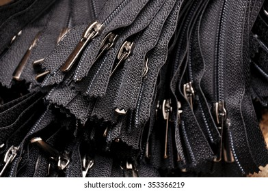 Black zipper close up. Many black zippers background.