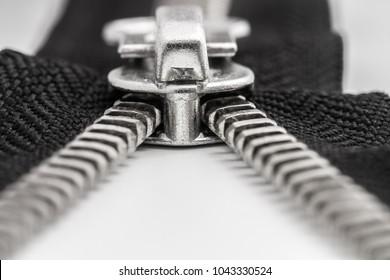black zipper and lock on white background, macro