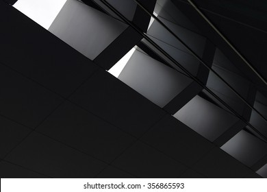 Black-and-white close-up photo of contemporary architecture fragment in backlight. Abstract minimalistic composition.