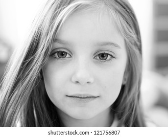 black-and-white portrait of a cute liitle girl