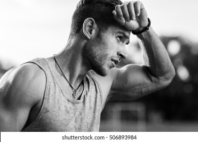 Black-and-white portrait of tired muscular male