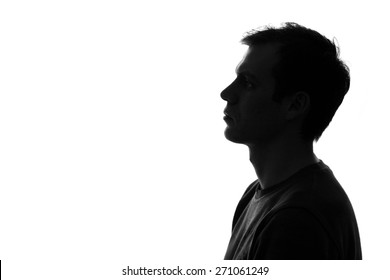 black-and-white silhouette of head of sad caucasian man on a white isolated background