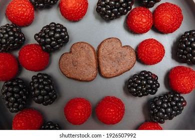 blackberries, blueberries and heart shaped cookie. Breakfast with love. To eat fruit. Love for food.
