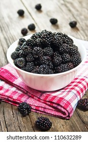 Blackberries in a bowl on wooden table
