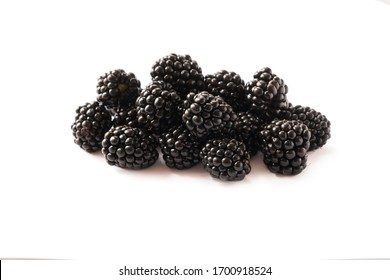 Blackberries isolated on white background. Blackberries with copy space for text. Ripe blackberry close-up. Background berry. Sweet and juicy berry. Heap of blackberries on white background.Black food