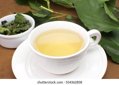 Blackberries leaf tea in wood background