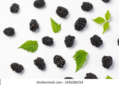 Blackberries and leaves top view on white background