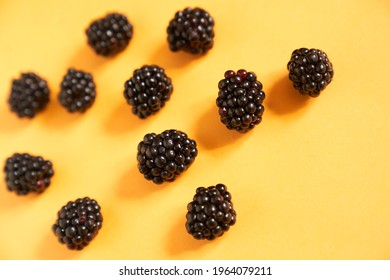 Blackberries on an illuminating yellow background. High quality photo