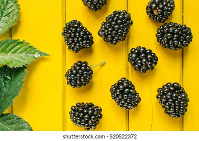 Blackberries on the yellow background