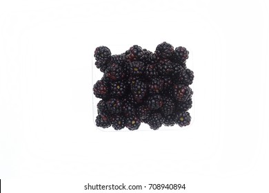 Blackberries in a plastic punnet on a white background