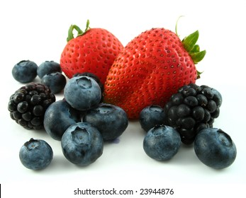 blackberries, strawberries, and blueberries isolated on white