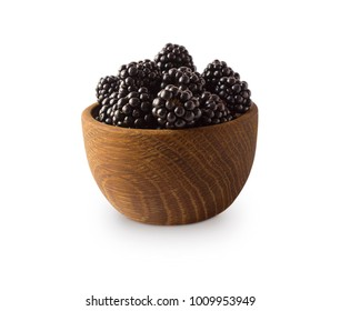 Blackberries in a wooden bowl with copy space for text. Ripe and tasty black berry isolated on white. Blackberries on a white background.