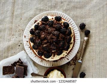 Blackberry cake with mascarpone cream and chocolate flat lay